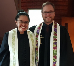 Photograph of Reverends Kelsey Hawisher-Faul and Peter Hawisher-Faul, Co-Pastors